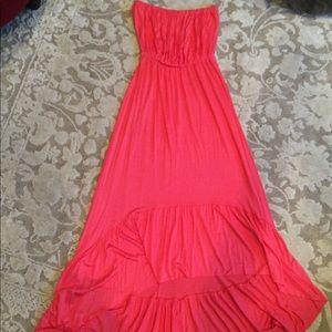 Sleeveless, full, salmon dress with bottom ruffle
